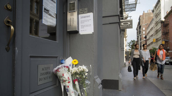 Supporters of the Patz family leave flowers on their doorstep in SoHo, Friday, May 25, 2012, in New York. New life has been breathed into the missing child case of Etan Patz after Pedro Hernandez implicated himself in the boy's death of the 6-year-old, whose disappearance 33 years ago on his way to school helped launch a missing children's movement that put kids' faces on milk cartons. (AP Photo/John Minchillo)