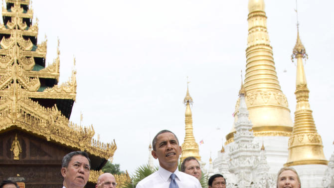 U.S. President Barack Obama, center, tours the Shwedagon Pagoda with Secretary of State Hillary Rodham Clinton, right, in Yangon, Myanmar, Monday, Nov. 19, 2012. This is the first visit to Myanmar by a sitting U.S. president. (AP Photo/Carolyn Kaster)