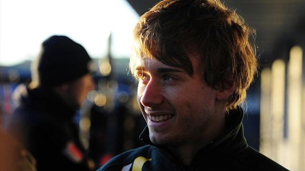 Caterham&#39;s French driver Charles Pic smiles during the unveil of the new Formula One car the Renault CT03 on February 5, 2013 (AFP)