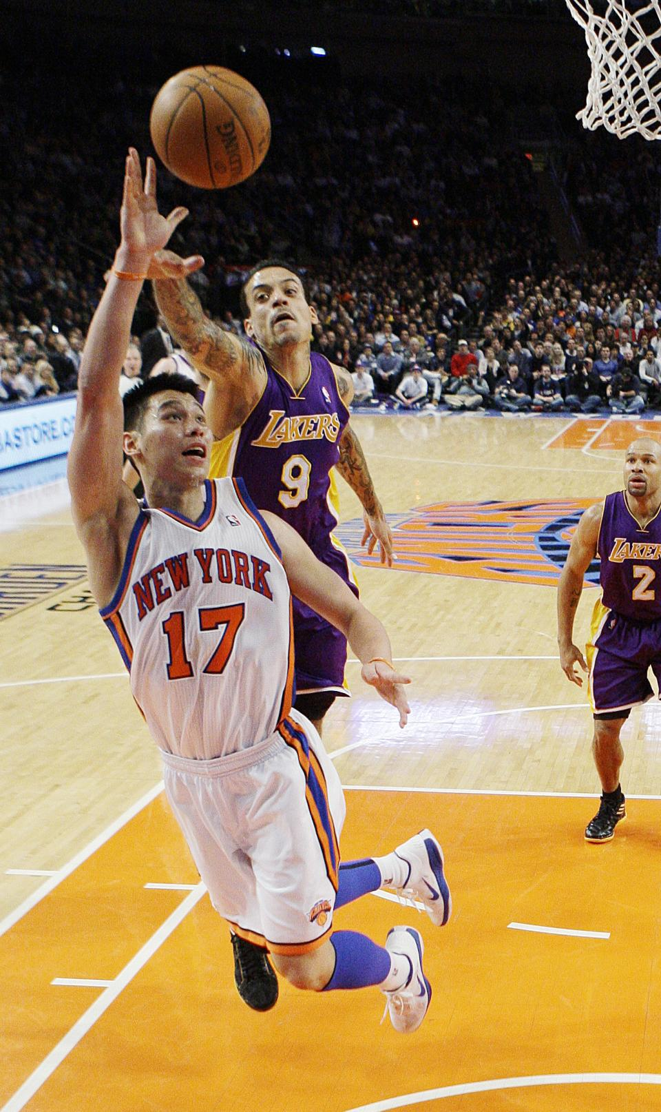 New York Knicks' Jeremy Lin (17) drives past Los Angeles Lakers' Matt Barnes (9) during the first half of an NBA basketball game, Friday, Feb. 10, 2012, in New York. (AP Photo/Frank Franklin II)