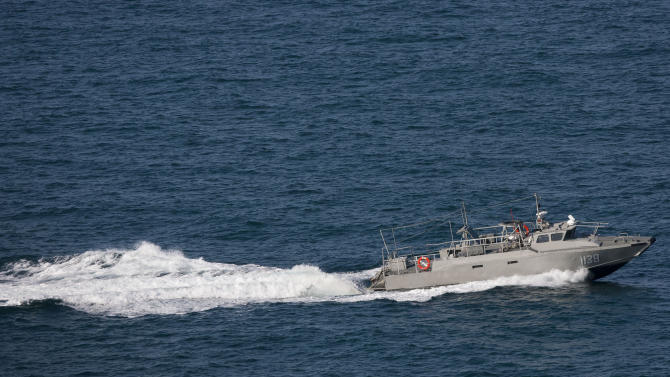 A Mexican Navy vessel searches the waters of the Gulf of California for survivors of a capsized fishing boat near San Felipe, Mexico, Monday, July 4, 2011. A U.S. tourist died after a fishing boat capsized in an unexpected storm in the Gulf of California off the Baja California peninsula and of the 44 people on the boat, seven U.S. tourists remain missing along with one Mexican crew member, the Mexican navy said. (AP Photo/Francisco Vega)