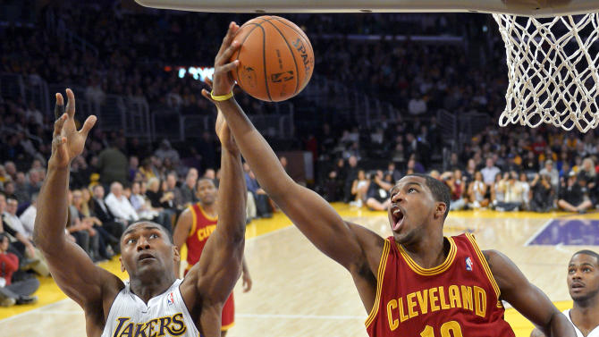 Los Angeles Lakers forward Metta World Peace, left, and Cleveland Cavaliers forward Tristan Thompson go after a rebound during the first half of an NBA basketball game, Sunday, Jan. 13, 2013, in Los Angeles. (AP Photo/Mark J. Terrill)