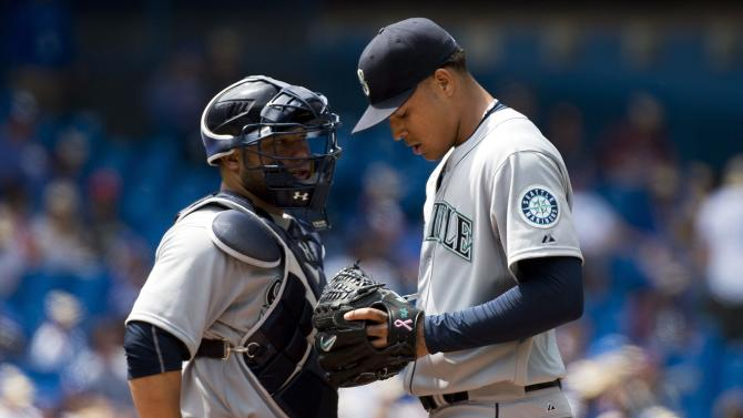 Seattle Mariners starting pitcher Taijuan Walker, right, talks with catcher Welington Castillo, left, after allowing four runs during fifth-inning baseball game action against the Toronto Blue Jays in Toronto, Sunday, May 24, 2015. (Nathan Denette/The Canadian Press via AP) MANDATORY CREDIT