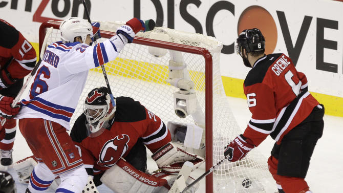 New York Rangers' Ruslan Fedotenko, left, of Ukraine, celebrates after scoring a goal past New Jersey Devils goalie Martin Brodeur, center, during the second period of Game 6 of the NHL hockey Stanley Cup Eastern Conference finals, Friday, May 25, 2012, in Newark, N.J. Devils' Andy Greene is at right. (AP Photo/Frank Franklin II)