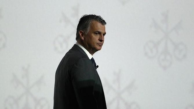 Swiss bank UBS Chief Executive Sergio Ermotti walks on the stage during the company's general shareholders meeting in Zurich