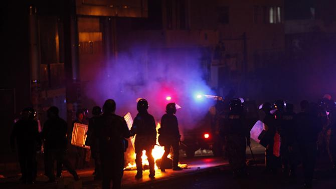 Jordanian anti-riot forces stand on alert near the Interior ministry Circle during a demonstration following an announcement that Jordan would raise fuel prices, including a hike on cooking gas in Amman, Jordan, Wednesday, Nov. 14, 2012. (AP Photo/Mohammad Hannon)