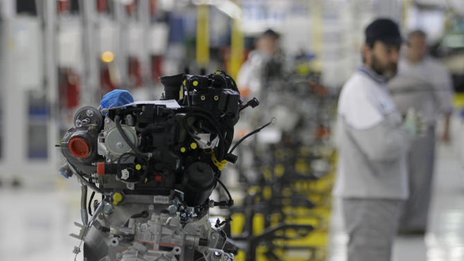 A Serbian factory worker looks at an engine of a Fiat 500 L car in the assembly hall in the new Fiat factory, in Kragujevac, some 100 kilometers (70 miles) south of Belgrade, Serbia, Monday, April 16, 2012. Italian carmaker Fiat has opened a production line in Serbia for its new 500L family model, to expand on the popularity of its two-door 500 city car. Fiat hopes to sell about 160,000 hatchbacks a year produced in this central Serbian town, to take advantage of low wages, tax breaks and government subsidies. (AP Photo/Darko Vojinovic)