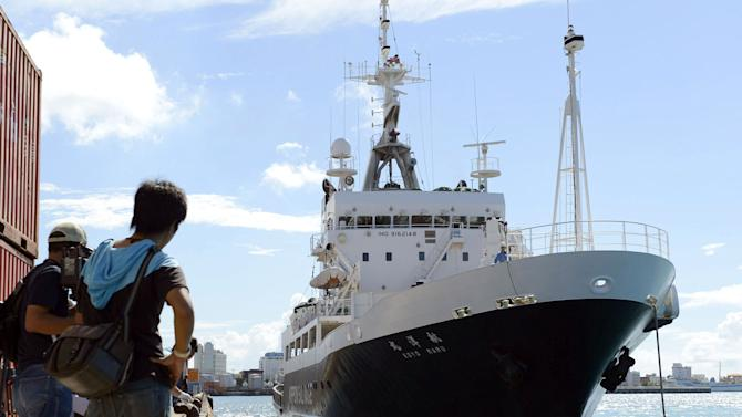 A survey ship dispatched from the Tokyo metropolitan government arrives at a port in Ishigaki, Okinawa Prefecture, Japan, Saturday, Sept. 1, 2012. Tokyo city officials intending to buy tiny islands at the center of a longtime territorial dispute with China will travel by the boat to survey the area ahead of the purchase they hope will bolster Japan's claim. (AP Photo/Kyodo News) JAPAN OUT, MANDATORY CREDIT, NO LICENSING IN CHINA, HONG KONG, JAPAN, SOUTH KOREA AND FRANCE