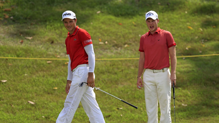 Julien Quesne, left, of France and Danny Willett of England look on on the third green during the third round of the Malaysian Open golf tournament at Kuala Lumpur Golf and Country Club in Kuala Lumpur, Malaysia, Saturday, April 19, 2014. (AP Photo/Lai Seng Sin)