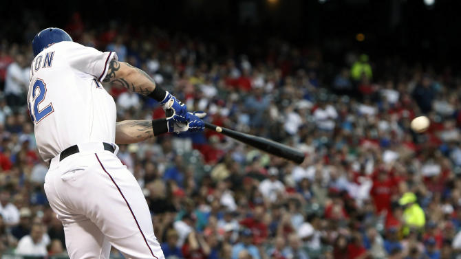 Texas Rangers Josh Hamilton makes contact for a double during the second inning of a baseball game against the Boston Red Sox, Thursday, May 28, 2015, in Arlington, Texas. (AP Photo/Brandon Wade)