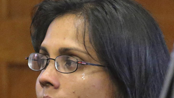 A tear runs down the cheek of former state chemist Annie Dookhan during a hearing Friday, Nov. 22, 2013, in Suffolk Superior Court in Boston, where she entered a guilty plea on charges of obstruction of justice, perjury and tampering with evidence. Dookhan, who admitted faking test results in criminal cases, was sentenced to three to five years in prison, followed by two years' probation. (AP Photo/The Boston Globe, David L Ryan, Pool)