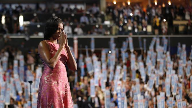 First Lady Michelle Obama waves after addressing the Democratic National Convention in Charlotte, N.C., on Monday, Sept. 3, 2012.  (AP Photo/Jae C. Hong)