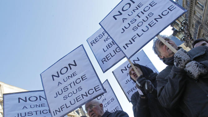 "Members of the Church of Scientology, protest outside the Paris courthouse in Paris, Thursday, Feb. 2, 2012. A French appeals court on Thursday upheld the Church of Scientology's 2009 fraud conviction on charges it pressured members into paying large sums for questionable remedies. Placards read, ""No to a justice under influence"". (AP Photo/Michel Euler)"
