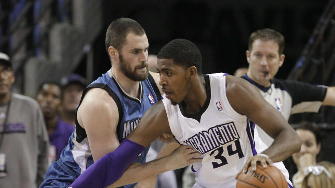 Sacramento Kings forward Jason Thompson, right, drives against Minnesota Timberwolves forward Kevin Love during the first quarter of an NBA basketball game in Sacramento, Calif., Tuesday, Nov. 27, 2012. (AP Photo/Rich Pedroncelli)