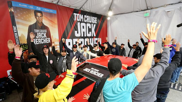 IMAGE DISTRIBUTED FOR PARAMOUNT HOME MEDIA DISTRIBUTION - Contestants face their first challenge as they battle to win a classic 1971 Chevelle SS, like the one featured in the action-packed film JACK REACHER, at a grueling competition that is now underway at the Hollywood & Highland Center on Monday, May 6, 2013 in Hollywood, Calif.  The competition celebrates the arrival of the movie on Blu-ray, DVD and Digital Download on May 7th. (Photo by Casey Rodgers/Invision for Paramount Home Media Distribution/AP Images)