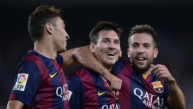 Barcelona's Lionel Messi (C) is congratulated by teammates Jordi Alba (R) and Munir after scoring a goal during a Spanish La Liga match at the Camp Nou stadium, in Barcelona, on August 24, 2014