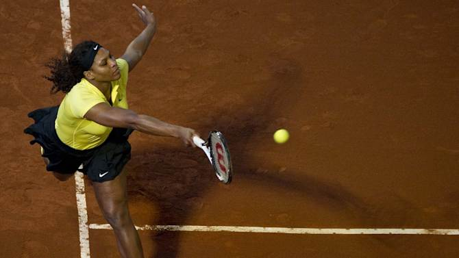 US tennis player Serena Williams returns a ball to her sister Venus Williams during an exhibition match at La Macarena bullring in Medellin on November 23, 2011. Venus won 6-4, 7-6 (7/4).  TOPSHOTS     AFP PHOTO/Raul ARBOLEDA (Photo credit should read RAUL ARBOLEDA/AFP/Getty Images)