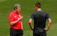 Roy Hodgson (left) hopes to be able to select John Terry in the future