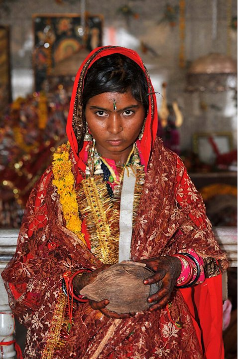 In this Friday, May 6, 2011 photo, child bride Smita,13, from  Raghogarh village, looks on at the Maa Jalapa Devi temple after her marriage ceremony in Rajgarh, about 155 kilometers (96 miles) from Bh