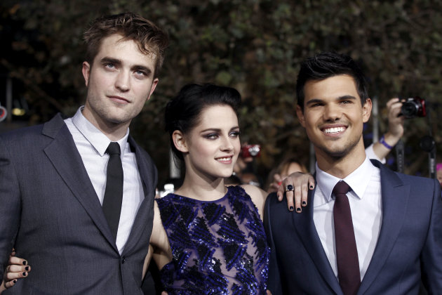 "Robert Pattinson, left, Kristen Stewart, center, and Taylor Lautner arrive at the world premiere of ""The Twilight Saga: Breaking Dawn - Part 1"" on Monday, Nov. 14, 2011, in Los Angeles. (AP Photo/Matt"