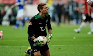 Hanover's goalkeeper Ron-Robert Zieler holds the ball during the German first division Bundesliga football match Hanover 96 vs Schalke 04 in Hanover, northern Germany. Champions League side Schalke were held to a 2-2 draw at Hanover on Sunday as the hosts came from behind on the opening weekend of the Bundesliga's 50th season