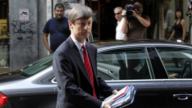 European Commission director, Matthias Morse, arrives for a meeting between Greece's finance minister Yannis Stournaras and the debt inspectors from the European Central Bank, European Commission and International Monetary Fund, known as the troika  at Greece's Finance ministry in Athens, on Tuesday, Sept. 18, 2012. Debt-strapped Greece is negotiating a major new austerity package worth more than euro 11.5 billion ($15.1 billion) with its rescue lenders. The measures are a requirement for continued emergency loan payments. (AP Photo/Petros Giannakouris)