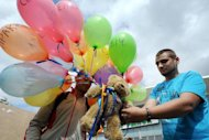 &lt;p&gt;An opposition activist attaches a teddy bear to the balloons in central Minsk on August 12 during an action in support of political prisoners. Belarus strongman leader Alexander Lukashenko on Monday fired his foreign minister as part of a sweeping reshuffle that follows a diplomatic crisis in ties with Sweden after a pro-democracy stunt allegedly involving teddy bears.&lt;/p&gt;