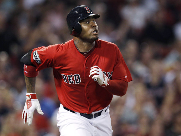 FILE - In this Aug. 3, 2012, file photo, Boston Red Sox's Carl Crawford watches his three-run home run against the Minnesota Twins during a baseball game in Boston. The Red Sox have traded first basem