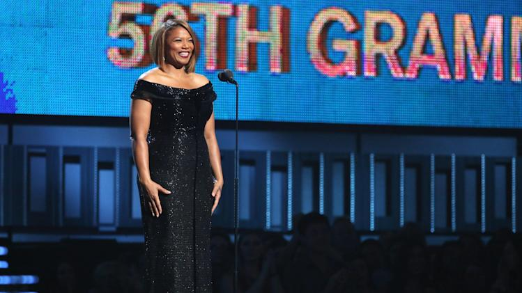 "Queen Latifah introduces a performance of ""Same Love"" by Macklemore Ryan Lewis, with Mary Lambert, Trombone Shorty and Madonna at the 56th annual Grammy Awards at Staples Center on Sunday, Jan. 26, 2014, in Los Angeles. (Photo by Matt Sayles/Invision/AP)"