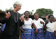 International Monetary Fund Managing Director Christine Lagarde dances with members of MicroLoan Foundation at Kasengere village in the suburb of Malawi's capital Lilongwe, on January 5, 2013. Lagarde on Saturday praised Malawi's President Joyce Banda for &quot;bold&quot; economic recovery reforms, saying the measures will lead to a turn-around despite their unpopularity.
