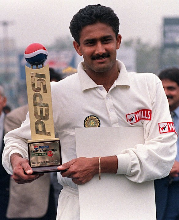 Anil Kumble holds his trophy after being declared man of the match after India won the second test against Pakistan 07 February. Kumble grabbed all 10 wickets in an innings emulating Jim Laker's f