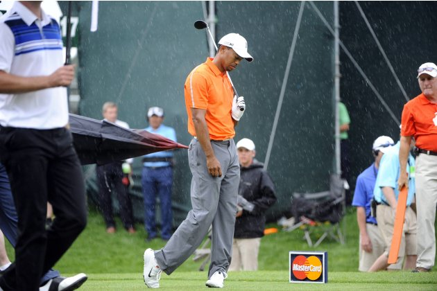 Tiger Woods of the U.S. reacts after his tee shot on the 18th hole during the second round play in the Arnold Palmer Invitational PGA golf tournament in Orlando