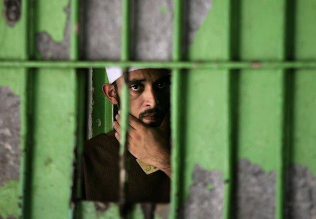 FILE - In this July 9, 2007 file photo, a Palestinian prisoner is seen at the Hamas-controlled Saraya prison in Gaza City. In a report released Wednesday. 3, 2012 international rights group Human Rights Watch says Hamas' security forces in Gaza are committing severe abuses, including torture of detainees, arrests without warrants, forced confessions, unfair trials and mock executions. (AP Photo/Kevin Frayer, File)