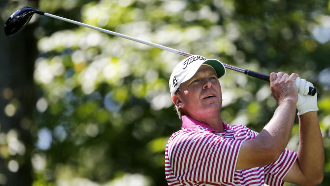 Steve Stricker watches his shot from the ninth tee during the Pro Am round of the Deutsche Bank Championship golf tournament at TPC Boston in Norton, Mass., Thursday, Aug. 30, 2012. (AP Photo/Michael Dwyer)