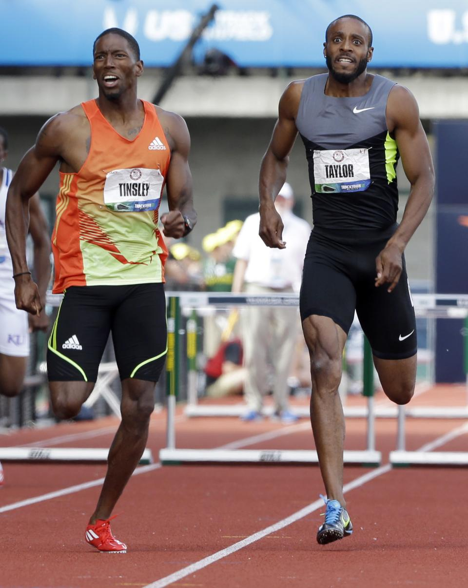 Michael Tinsley and Angelo Taylor battle for first in the finish of the men's 400 meter hurdles at the U.S. Olympic Track and Field Trials Sunday, July 1, 2012, in Eugene, Ore. (AP Photo/Eric Gay)