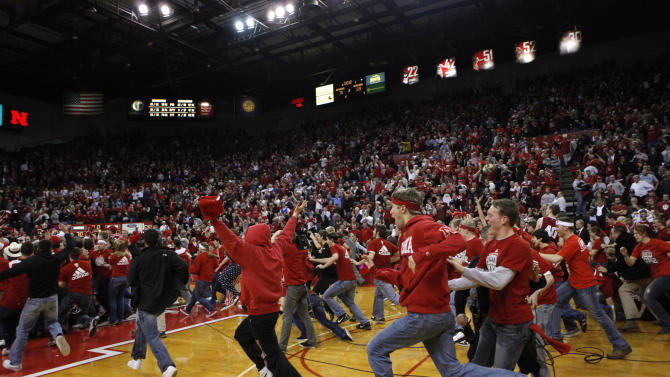 Nebraska fans storm the court after Nebraska defeated Indiana 70-69 in an NCAA college basketball game in Lincoln, Neb., Wednesday, Jan. 18, 2012. (AP Photo/Nati Harnik)