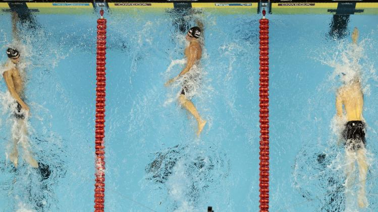 U.S. Ryan Lochte, center, outsprints Michael Phelps, right, and France's Yannick Agnel, to win the gold medal in the men's 200m Freestyle final at the FINA Swimming World Championships in Shanghai, China, Tuesday, July 26, 2011. (AP Photo/Gero Breloer)