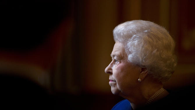 Britain's Queen Elizabeth II escorted by British Foreign Secretary William Hague, unseen, tours The Foreign and Commonwealth Office during an official visit which is part of her Jubilee celebrations in London, Tuesday, Dec. 18, 2012. (AP Photo/Alastair Grant, Pool)