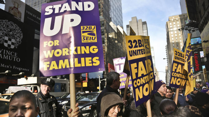 Cleaners, porters and matrons of theater union SEIU Local 32BJ demonstrate outside the Broadway League's office  on Wednesday, Dec. 12, 2012, in New York. The union representing hundreds of Broadway theater cleaners, porters, elevator operators and bathroom attendants voted Wednesday to authorize its leaders to call a strike if a new contract isn't approved by the end of the month, (AP Photo/Bebeto Matthews)
