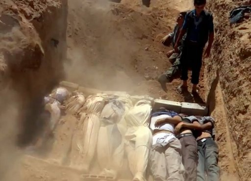 A video image uploaded on YouTube by the Local Committee of Arbeen on August 21, 2013 shows a mass grave containing bodies of victims of an alleged toxic gas attack by pro-government forces on the outskirts of Damascus