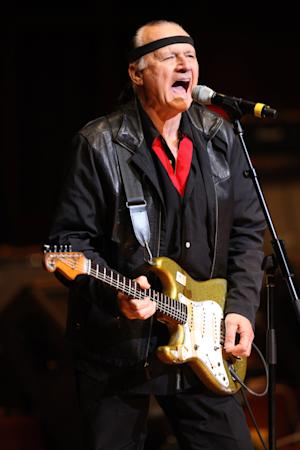 "FILE - This Oct. 12,2009 file photo shows Dick Dale performing in Nashville, Tenn. The son and ex-wife of 1960s ""King of the Surf Guitar"" Dale were arrested after they allegedly blew up a propane tank in a Southern California desert town. Jill Monsour, 45, and James Monsour, 20, were arrested on suspicion of possessing an explosive device in public. (AP Photo/Josh Anderson,FILE)"