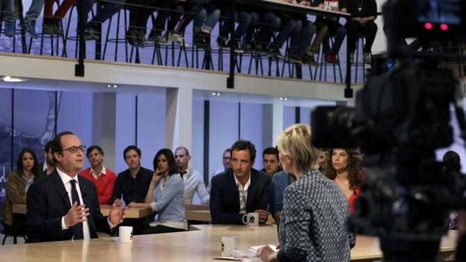 French President Francois Hollande attends Canal Plus television midday programme in Paris