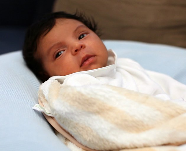 In this undated image released by Beyonce.com, Blue Ivy, the daughter of performers Beyonce Knowles and Jay-Z, is shown in a recent family photo. Photos of the 1-month-old were posted by her parents o