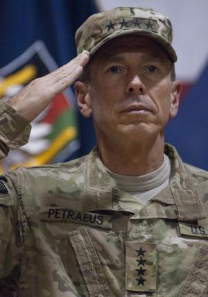 "-- ADDS DAY AND DATE PHOTO WAS MADE -- In this photo provided by ISAF Regional Command (South), U.S. Army Gen. David H. Petraeus, commanding general of the NATO International Security Assistance Force (ISAF) and U.S. Forces Afghanistan (USFOR-A), salutes before administering the oath of re-affirmation and re-enlistment to 235 U.S. service members during a ceremony called ""Operation Enduring Commitment - The Red, White and True,"" held at Kandahar Airfield in Kandahar, Afghanistan, Monday July 4, 2011. (AP Photo/ U.S. Navy Lt. j.g. Haraz N. Ghanbari)"