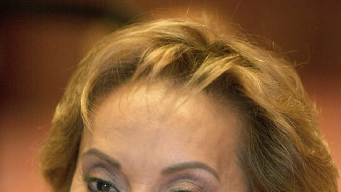 FILE - This May 12, 2003 file photo shows Elba Esther Gordillo, then secretary general of the Institutional Revolutionary Party (PRI) speaks at a news conference with foreign correspondents in Mexico City. Gordillo, the head of Mexico's powerful teachers' union, was arrested at an airport outside Mexico City on Tuesday, Feb. 26, 2013, for alleged embezzlement, with federal officials accusing her using union funds to pay for plastic surgery, buy a private plane and even pay her bill at Neiman Marcus. (AP Photo/Eduardo Verdugo, File)