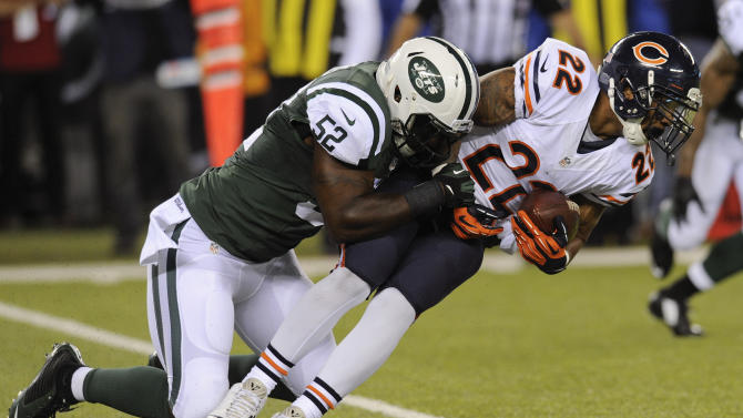 Chicago Bears running back Matt Forte (22) is tackled by New York Jets inside linebacker David Harris (52) in the first quarter of an NFL football game, Monday, Sept. 22, 2014, in East Rutherford, N.J. (AP Photo/Bill Kostroun)