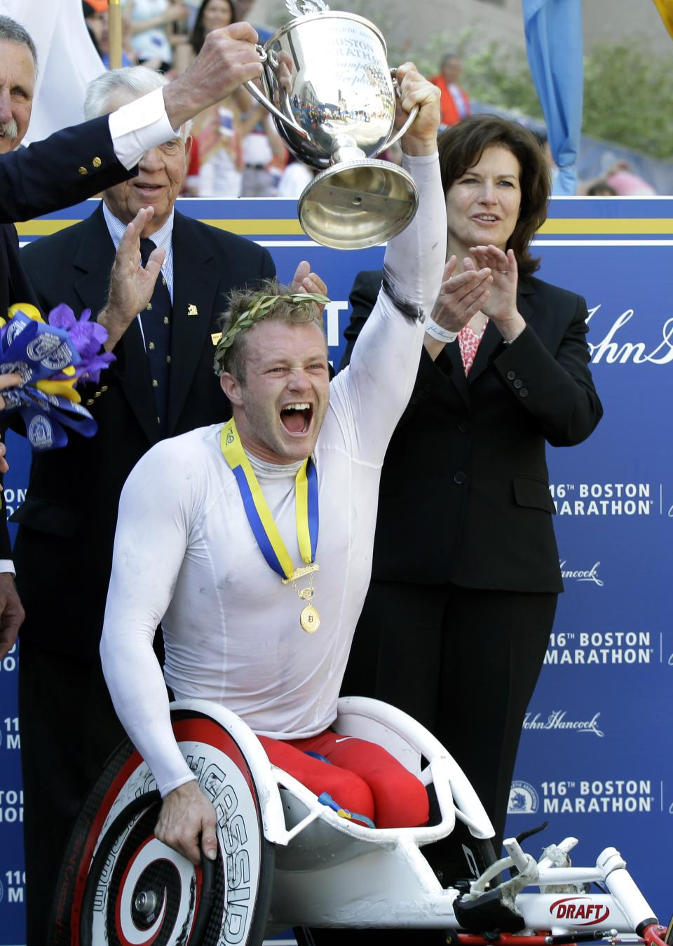 Men's wheelchair winner Joshua Cassidy of Canada reacts with his trophy at the finish area of the 2012 Boston Marathon in Boston, Monday, April 16, 2012. (AP Photo/Elise Amendola)