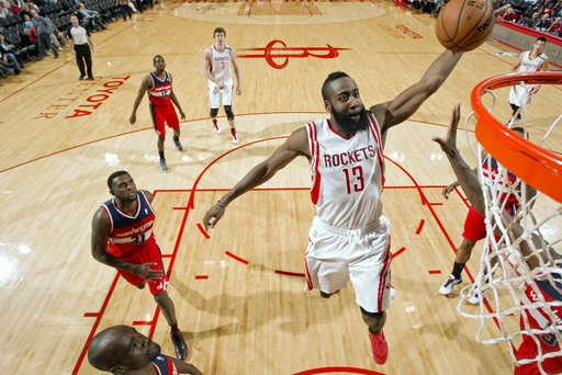 HOUSTON, TX - DECEMBER 12:  James Harden #13 of the Houston Rockets rises for a dunk against the Washington Wizards on December 12, 2012 at the Toyota Center in Houston, Texas. (Photo by Bill Baptist/NBAE via Getty Images)