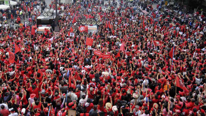 Protesters of the United Front for Democracy against Dictatorship (UDD), or Red Shirt, rally to mark the sixth month anniversary of the May military crackdown on the protesters, Friday, Nov. 19, 2010 in Bangkok, Thailand, (AP Photo)