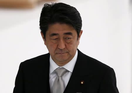 Japan's PM Abe attends a memorial service ceremony marking the the 69th anniversary of Japan's surrender in World War Two, at Budokan Hall in Tokyo